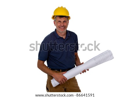 A professional construction contractor worker with hard hat is holding construction blue print plans, isolated on a white background.