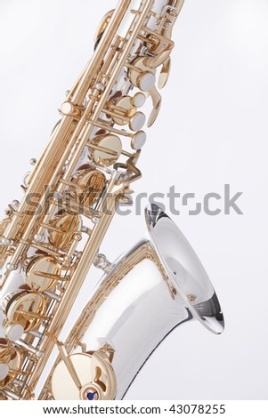A professional gold and silver alto saxophone isolated against a white background.