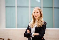 A professional Linkedin head shot for an attractive Russian woman who is an expat in Asia. She is attractive, beautiful and confident.