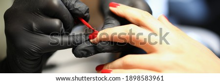 A professional manicurist provides services to women. Beautiful and well-groomed hands with a perfect shape of nails Stok fotoğraf ©