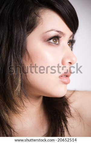 A profile shot of a beautiful asian girl