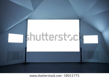 a projection screen and two tv in the exhibition Room - stock photo