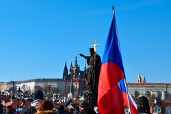 A protest in Prague, Czech Republic , Charles Bridge and Prague castle, demonstration, march, people, liberty, demission, Andrej Babis, covid restrictions, lockdown, pandemic, statue of Jan Nepomuk