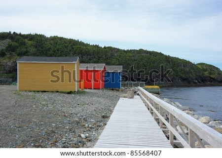A public boardwalk and colourful buildings in Trout River, Newfoundland, Canada.