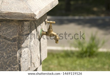 a public faucet in a public park