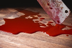 A puddle of blood and rusty knife. Murder.
