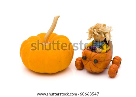 A pumpkin with a little scarecrow driving a pumpkin isolated on white, autumn