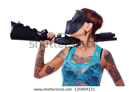 A punk girl in a mask posing with a shotgun