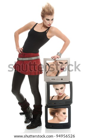a punk girl posing with tv sets