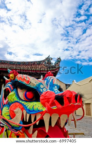 A puppet oriental dragon head with clear blue skies