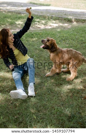 A puppy briard playing with his owner #1459107794