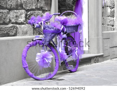 A purple bicycle - stock photo
