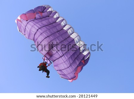A purple parachute on a bright sunny day.