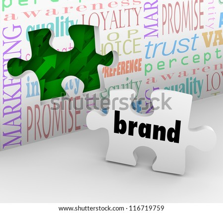 A puzzle piece with the word Brand is your final answer completing your marketing strategy to build awareness and customer loyalty - stock photo