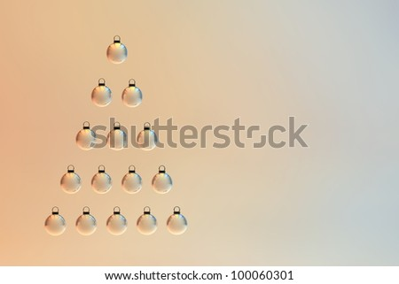 A pyramid shape made out of Christmas baubles. Christmas tree ornament