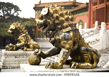 stock-photo-a-qing-era-guardian-lion-pair-within-the-forbidden-city-beijing-44898568.jpg