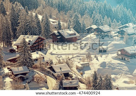 A quaint village in the Swiss Alps during winter. Added vintage filter.