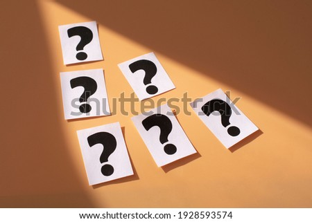 a question mark on a white sheet . FAQ frequency asked questions, Answer and Brainstorming Concepts