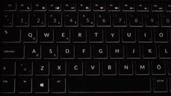 A QWERTY laptop keyboard, black laptop keys
