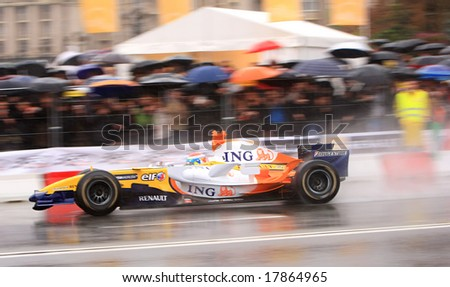 A R27 races down the streets of Kyiv during the ING Renault Roadshow on Sunday, September 21, 2008