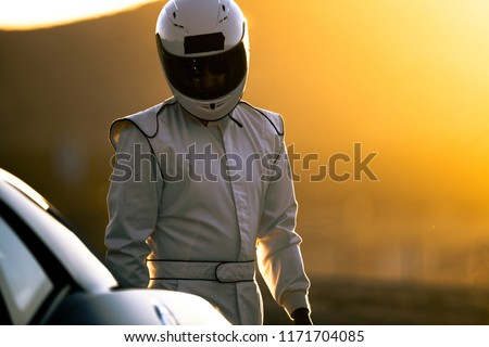 A Race Car Driver In The Early Morning Sun #1171704085