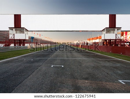 a racetrack with an empty board, for filling with text o logo. It can be used as conceptual business picture. Focus is on the board