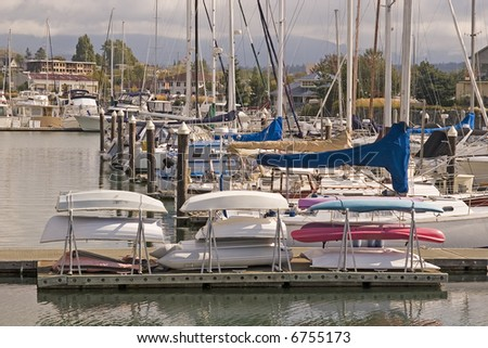 A rack of canoes and rowboats at a marina - stock photo