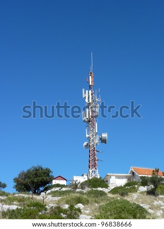 A radio antenna at the top of a mountain