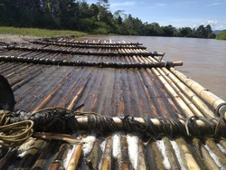 a raft is a tool for crossing rivers made of wood and bamboo, which is available in remote villages