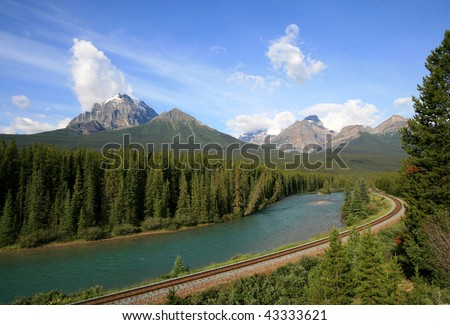A railroad along the Bow River near Lake Louise in Banff National Park, Alberta, Canada.