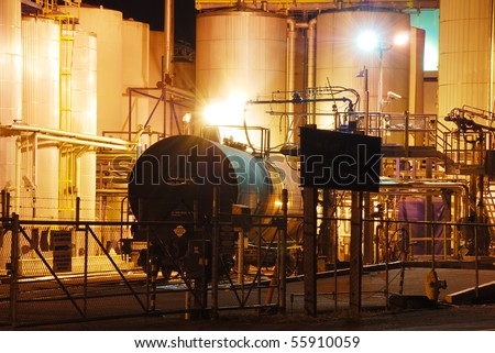 A railroad tanker is being off-loaded at  a chemical plant in Albany Oregon.  Tanker is loaded with a poisonous liquid.