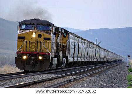 A railroad train coming down the tracks