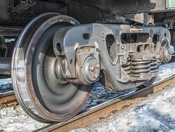A railway bogie on the rails. Close-up.