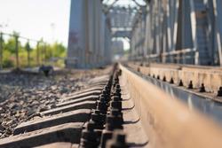 A railway for trains passing through a cast-iron bridge.
