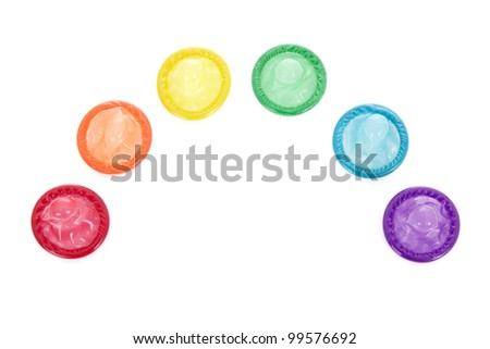 A rainbow of colored condoms, isolated on a white background.
