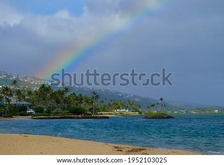 A rainbow on a beach in O'ahu island - Hawaii Stok fotoğraf ©