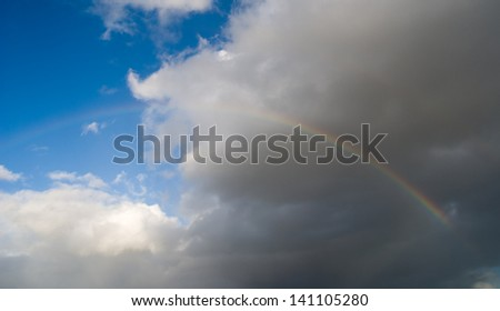 A rainbow over a dark sky after the storm.