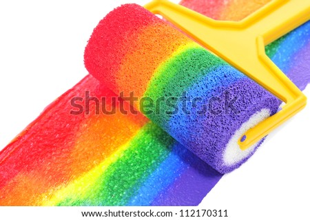 a rainbow painted with a paint roller on a white background - stock photo