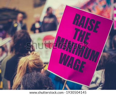 A Raise The Minimum Wage Sign At Worker's Rights Protest Or Rally Stock photo ©