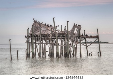 A ramshackled weathered building at Cedar Key, Florida on a wintery evening.