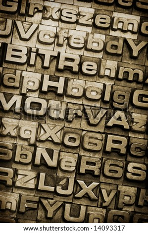 A random letterpress type background. Selective focus. Hand tinted for an antique look. Part of a background series.