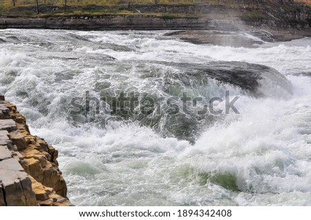 A rapid on the north river. Landscape with white water on a rapid. ストックフォト ©
