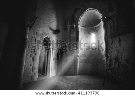 A RAY LIGHT IN A LITTLE CHURCH IN A LITTLE CASTE IN SICILY