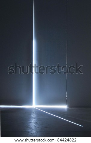 A ray of light coming through from a door