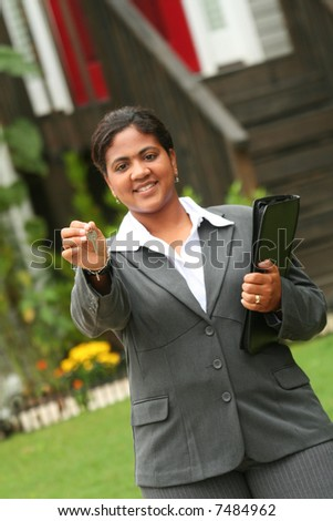 A real estate agent ready to sell a house