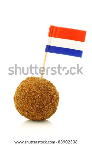 "A real traditional Dutch snack called ""bitterbal"" with a Dutch flag toothpick on a white background"