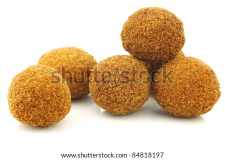 "a real traditional Dutch snack called ""bitterballen"" on a white background"