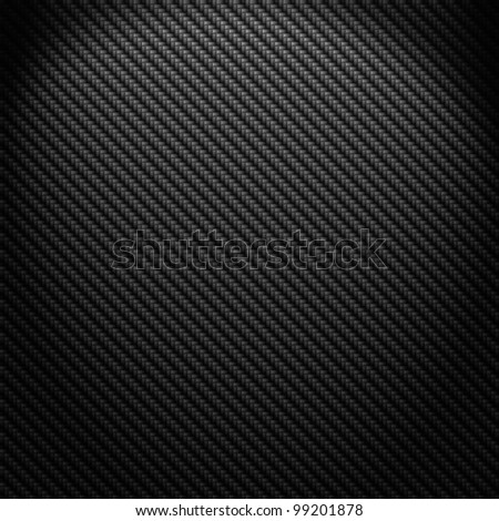 A realistic dark carbon fiber weave background or texture - stock photo