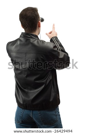 A rear view of a spectator wearing a leather jacket, and pointing at something, isolated against a white background