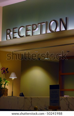 A reception desk at a modern hotel